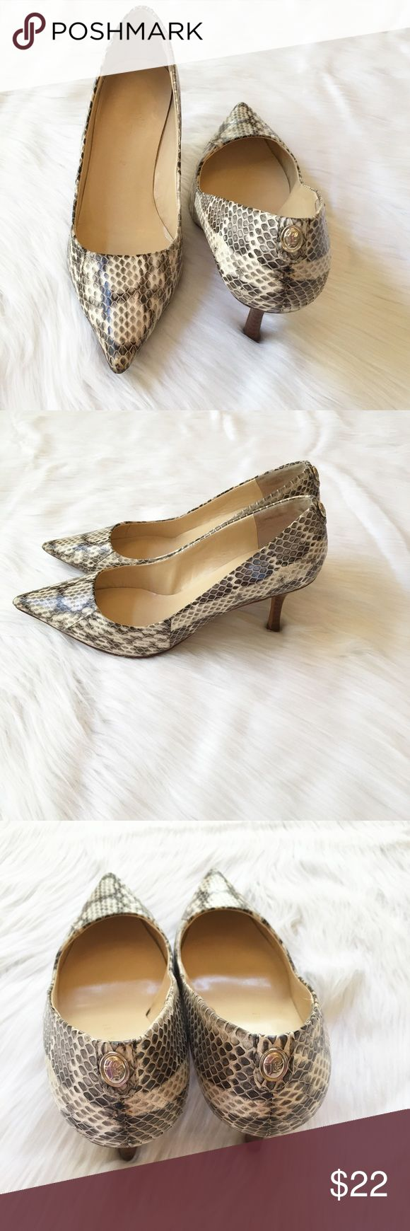 """Ivanka Trump Pumps This is a pair of Ivanka Trump pumps in used condition. They are a snake skin print leather upper with a leather sole. Only visible wear is on the bottom and a small scuff on the tip of the toes (as seen in picture above). Heel height is 2"""". ⚜Please see my """"reasonable offers"""" listing at the top of my page before submitting an offer⚜Thank you😊 Ivanka Trump Shoes Heels"""
