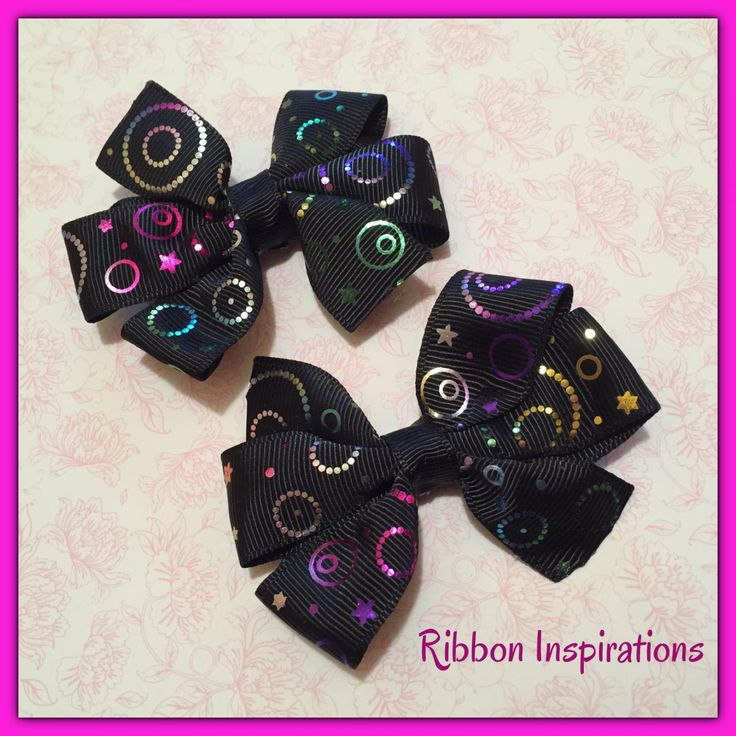 Pair of pinwheel bows on lined alligator clips with non slip grip.