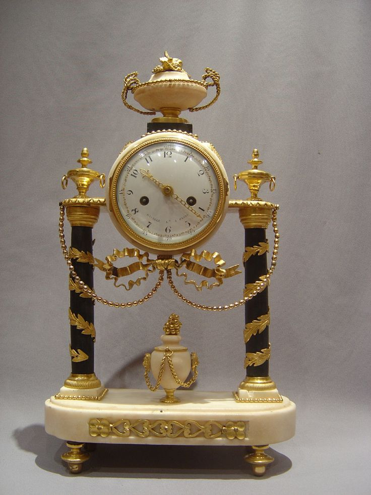 French antique Louis XVIth mantel clock in white and black marble with ormolu signed Gavelle.