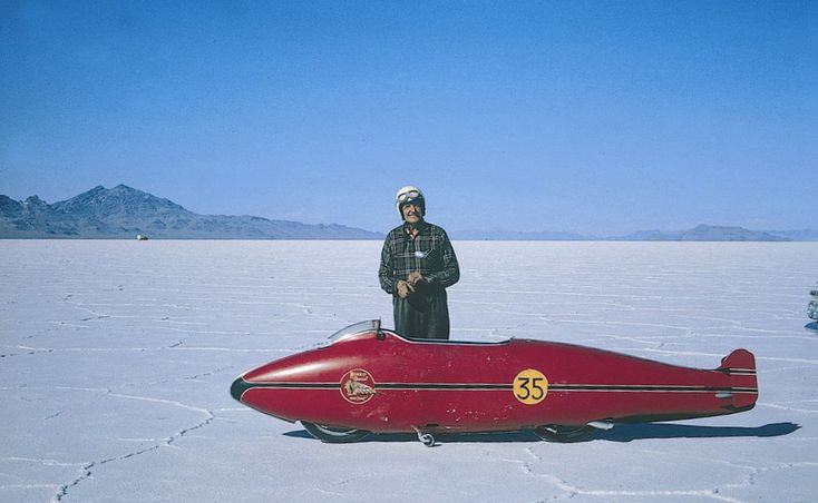 """Burt Munro with his Munro Special at Bonneville in the 1960s. At 63 years old  setting the world for driving (and building) the fastest indian:    Munro was 63 at the time with a bad heart, yet he still managed to overcome numerous obstacles to set world records, even as a muffler was burning the flesh on his leg. In 1967, Munro coaxed his beloved streamlined Indian to 183.58 mph. That set a record in the category of """"streamlined motorcycles under 1,000cc."""""""