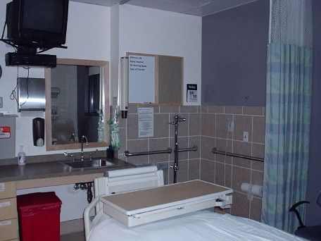 "picture of a hospital ghost - I had to look at this truly supernatural photo a few times. Taken from the excellent www.coasttocoastam.com, this is what they say: ""At an ICU in a hospital in Colorado, a nurse was testing her flash in the room with the lights off. Unknown date other then recently. Calendar is on the wall but not sure if it has the correct date on it.""  I really like the fact that the ghostly gentleman is actually looking directly into the camera. Shivers!"