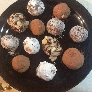 Truffles, 4 ways , 10x. Sugar, cocoa, almonds and fine coconut! YumMe! 2 cups chic chips, 1 cup heavy cream scalded, pour cream over chips, mix until smooth, chill 3+ hours, scoop, roll, decorate, chill and enjoy! Delish, fancy schmancy and so do easy!