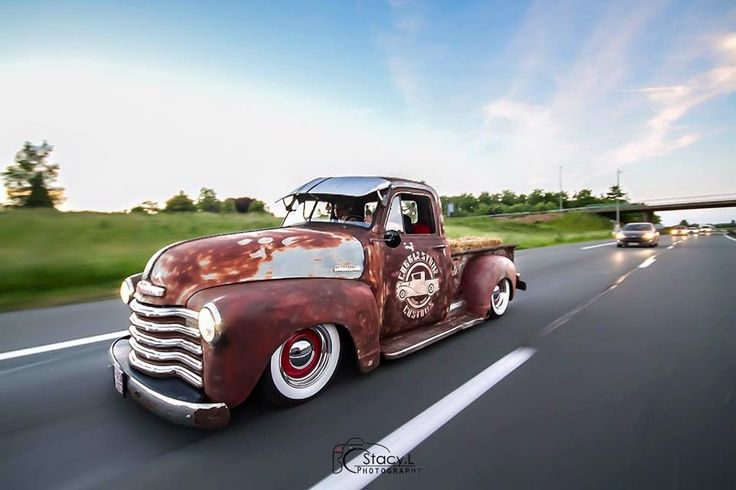 Ratrod Jalopy Daily Driver shop truck Chevy Advanced Design pickup truck slammed over red steel wheels with beauty rings, wide white wall tires and custom door graphics topped off with a Fulton adjustable visor.