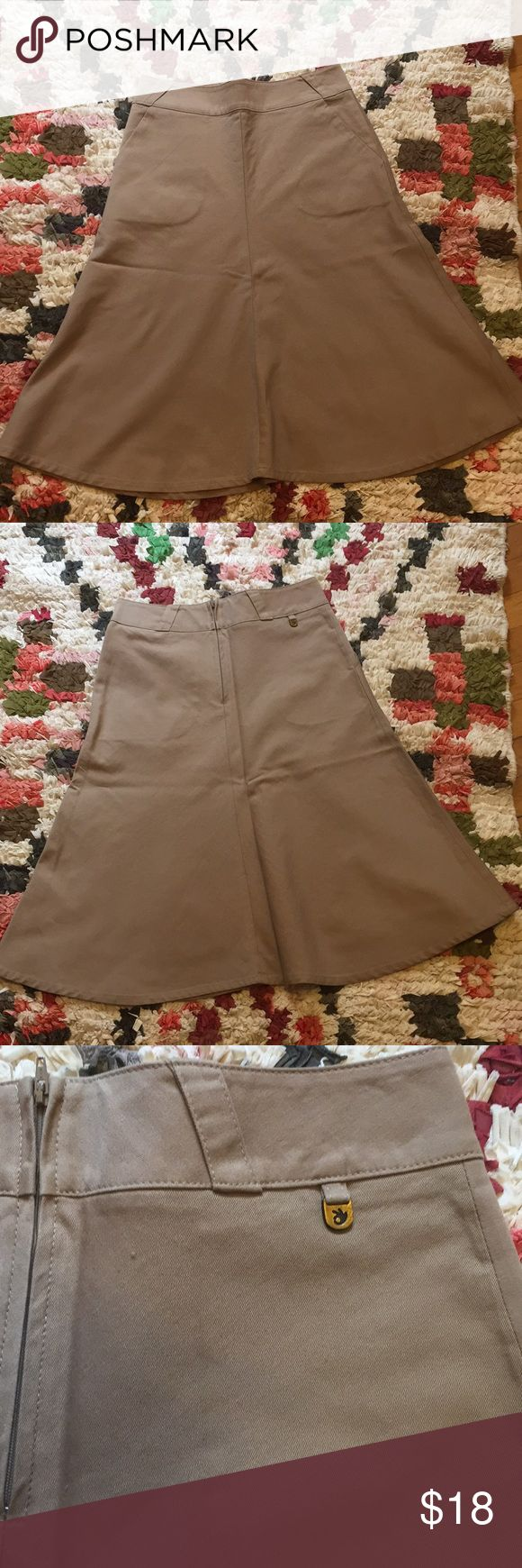 Boutique label Khaki skirt, XS. Purchased at a boutique in Washington, DC, skirt is adorable and in good condition. Comes with adorable belt! See images for details. About OK47 -- street-wear label no longer in production. We started with 6 Men's t-shirts and ended up with a full-fashion line, available in boutiques around the world. A design-driven clothing line. OK47 Skirts A-Line or Full