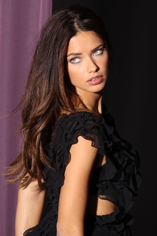 Adriana is night-out ready in black chiffon ruffles.