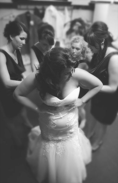 Wedding captured in a single moment. The race to dress the bride. @Color Photo