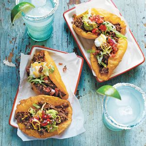 Puffy Tacos. Stuff with ground taco meat, shredded lettuce, diced tomatoes, and shredded cheese.