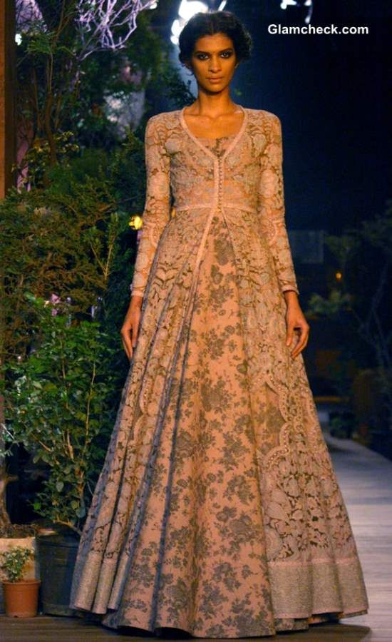 I am in love with this dress! But I don't know if a Paki darzee can pull it off. The fitting at the top is exquisite. The way it flares at the bottom is beautiful. I would wear this to an Amreeki wedding.