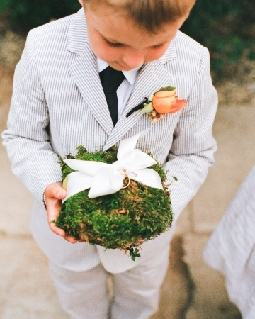 This ring bearer took his work very seriously! A moss pillow carried wedding bands tied with a white satin bow, and he sure kept his eye on it