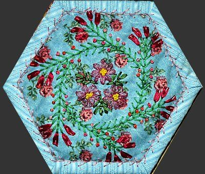 Ribbon embroidery can enhance a placemat, quilt, coaster or anywhere you can sew!