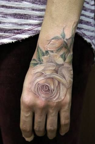 So subtle and pretty, but I wonder how long it will last? white rose tattoo - Google Search