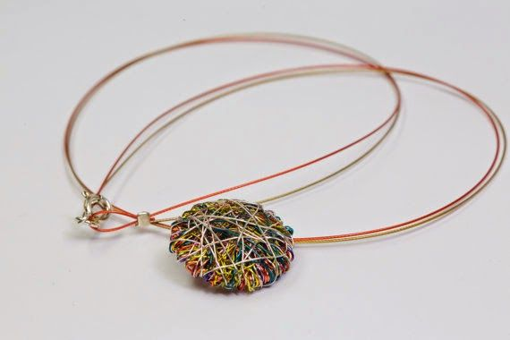 www.vmikro.etsy.com https://www.etsy.com/listing/232008691/geometric-necklace-geometric-jewelry?ref=shop_home_active_1 #Geometric #necklace #Geometricjewelry #Round necklace #Wiresculpture #Statementnecklace #Minimalist necklace #Multicolornecklace #Cutenecklace. Hand made wire sculpture geometric necklace, round statement necklace, geometric jewelry made of colored copper wire and silver. The overall size of the minimalist art necklace is 2 cm. (0.8 in). The cute multicolor necklace…