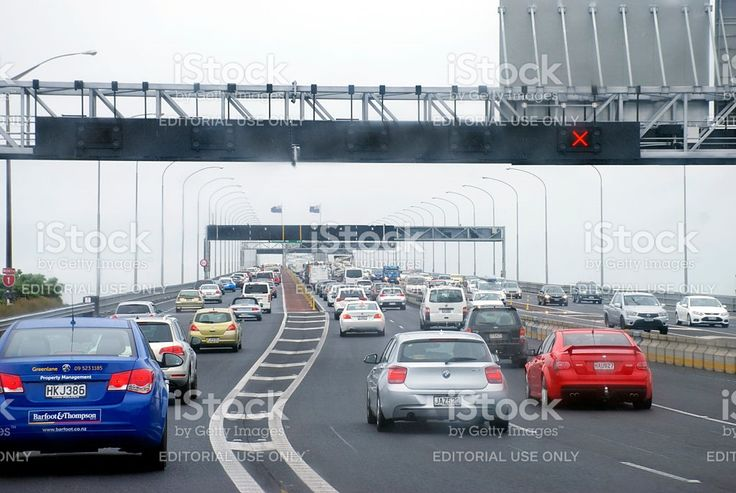 Traffic on Auckland Harbour Bridge, New Zealand royalty-free stock photo