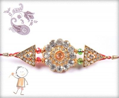 buy online rakhi - #Designer #Diamond #Traditional #Rakhi, Traditional OM Pendent Diamond Rakhi, surprise your loved ones with roli chawal, chocolates and a greeting card as it is also a part of our package and that too without any extra charges. http://www.bablarakhi.com/