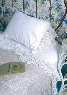 Romantic crochet-edged sheets, iron bed, floral wallpaper. . . beautiful combination