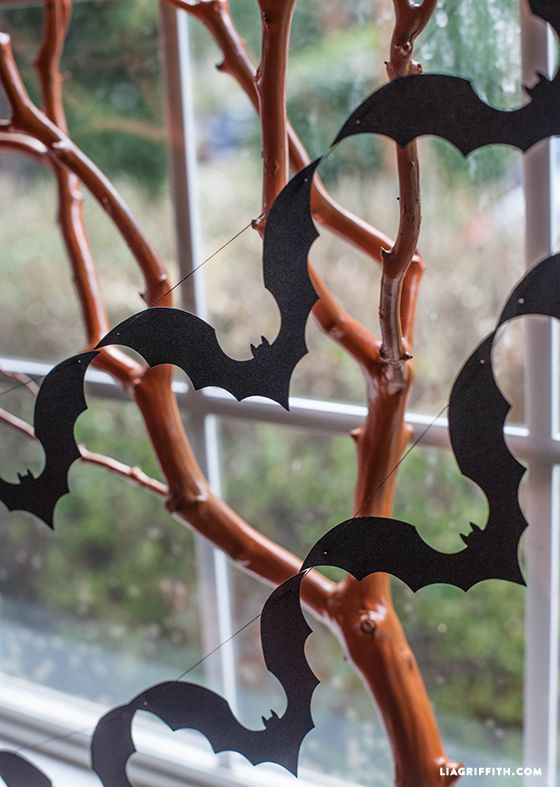 This garland is a perfect weekend project and is easy enough for kids to join you. Simply use the bat pattern to cut all of your bats from a black paper. Of course we used metallic black paper to add a little sheen. Using a needle and black thread, sew your bats together from wing to wing to create this pretty garland. http://liagriffith.com/diy-halloween-decorations-make-a-paper-bat-garland/