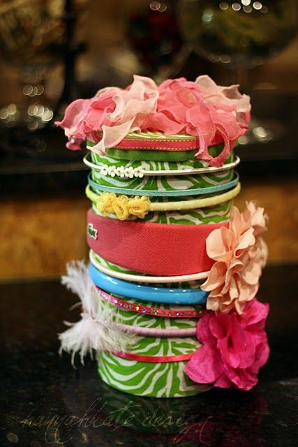 Cover empty oatmeal container to use as storage for headbands. Such a great idea