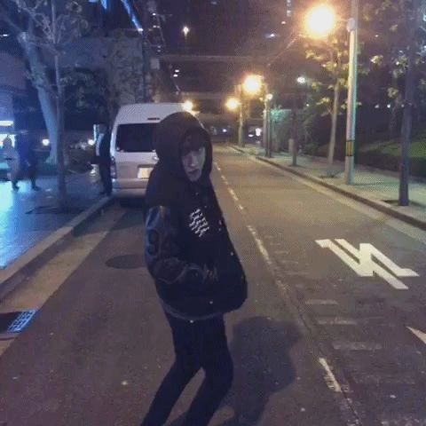 This looks like you've been picking on Chanyeol, and now he's fed up, and he's coming over to you to get you to stop, and and he'll get you to stop by either kissing you on the forehead or by bear-hugging you, your decision.