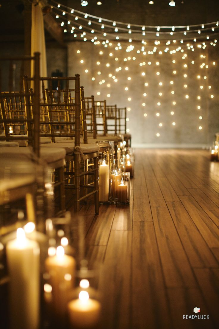 Candlelit wedding ceremony with fairy lights | Lindsay Hite of Readyluck | Brides.com