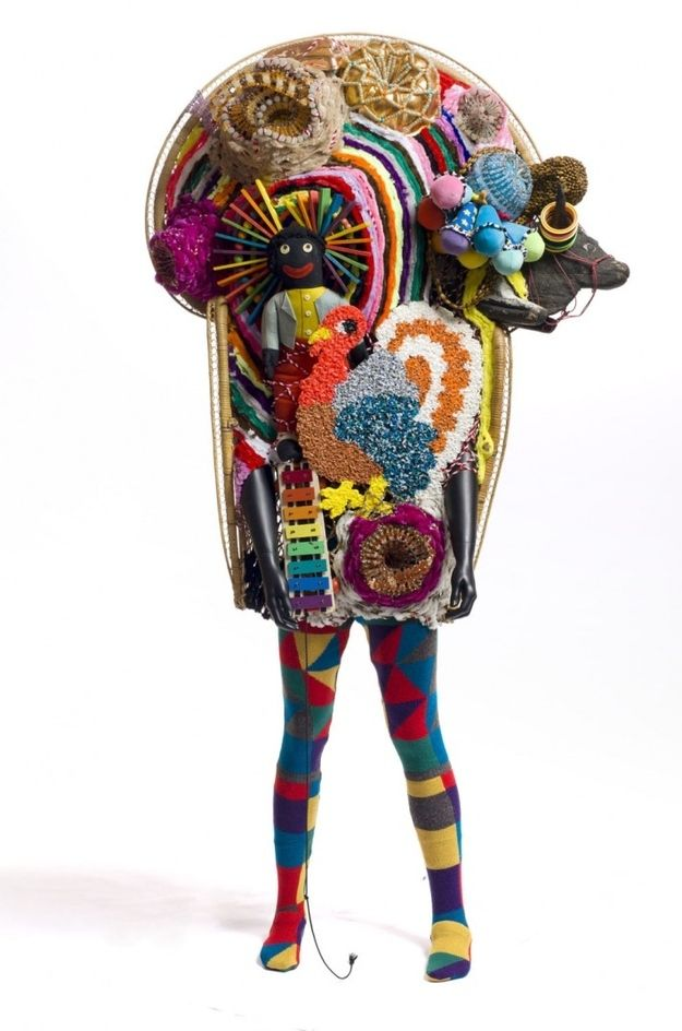By Nick Cave. This looks like it is just made out of felt? I love Nick Cave, and I love the crazy pieces of art that he creates! So amazing. Period.