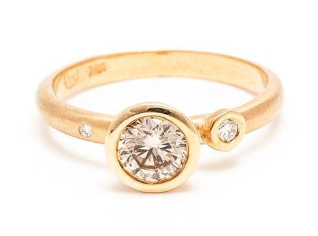 The asymmetry of this ring is great. This could make an interesting family ring if one replaced the side stones with the birthstones of one's spouse, children, siblings etc.