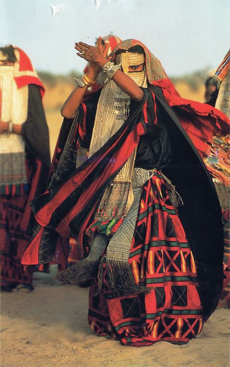 """""""Women of the African Ark series. Rashaida woman dancing, Eritrea."""" Photograph by Carol Beckwith and Angela Fisher. *Sorry the top is a bit torn."""