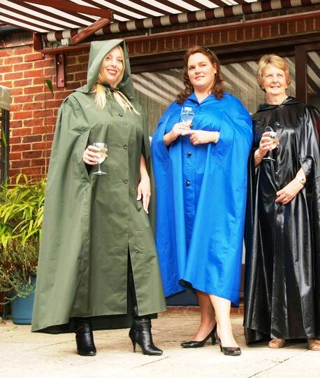 Enjoying a glass of wine in their lovely raincapes