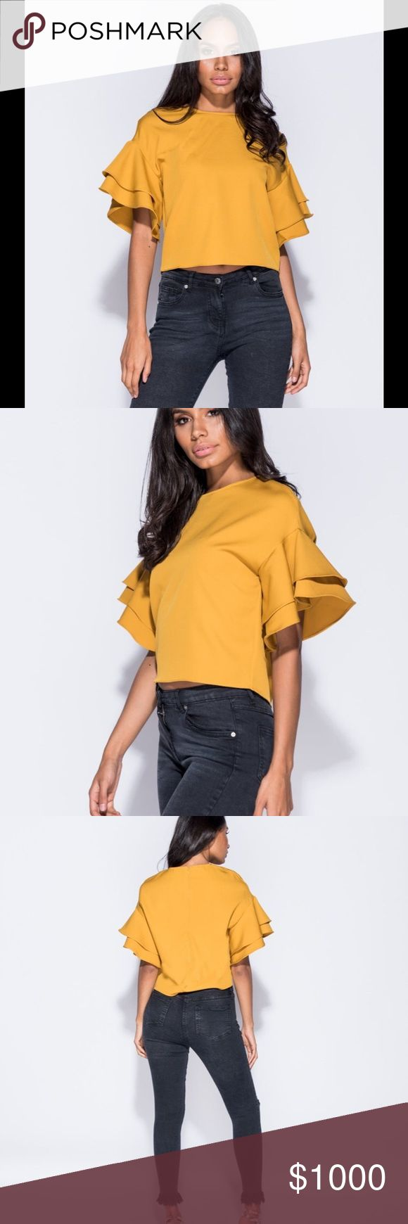 coming soon!!! Frill sleeve round neck top!! Hit all the right style notes this season with this European imported top!  Mustard color is SOOO In this season !!! Crepe fabric, so this item does have some stretch if in between sizes ❤️   Tags: free People, Zara, philosophy, lulus, fashion nova, tobi, misguided, Bebe, bcbg Philosophy Tops Blouses