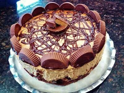 Peanut bytter cup cheesecake  http://foodiesnetwork.tv/peanut-butter-cup-brownie-bottom-cheesecake/