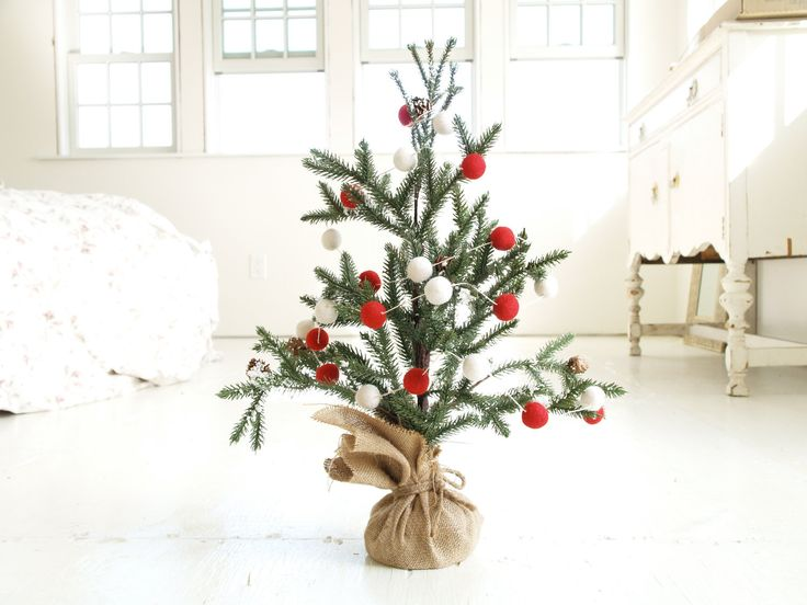 There is something so quaint about this Christmas Tree and Felt Garland  ($100) with a burlap base.