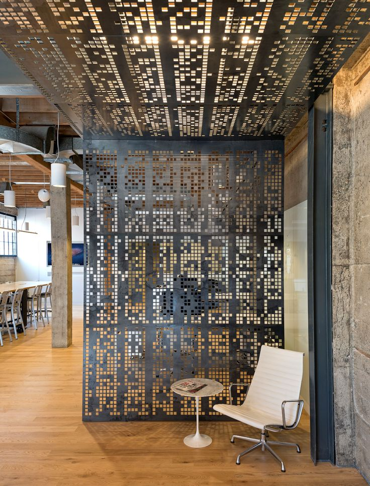 My favorite interrior laser-cut steel room divider.  Could use on downstairs boogramen as privacy screening. Giant Pixel design. oplusa-giantpixel_office-4
