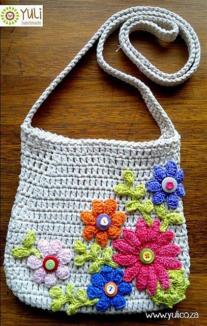 The pdf pattern gives instructions for a plain cross-body sling bag with shaping. The designer shows her bag which she has decorated with crocheted flowers and leaves.
