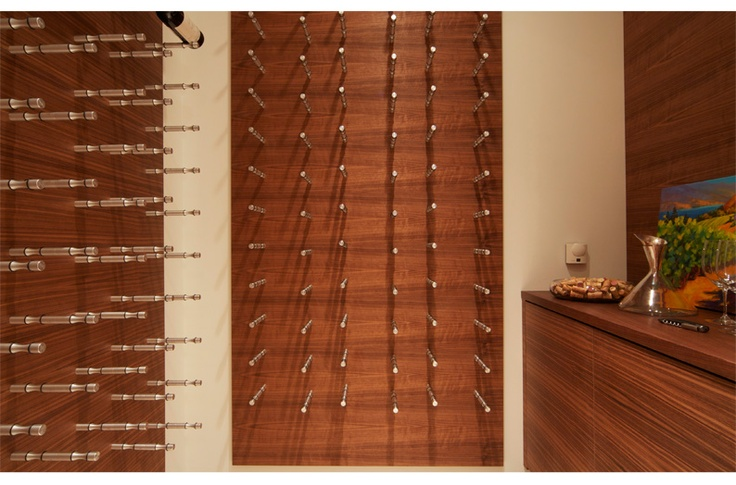 Nek-rite modular wine cellar storage system. Designed to store wine bottles horizontally to feature the labels and beautifully display fine wine collections. This way there's no more searching for a bottle while looking at neck tags or pulling the bottle out to see it.  Brilliant.