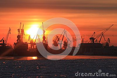 View of the Neva River in the area of Admiralty Shipyards during sunset on a winter day. Saint-Petersburg, Russia