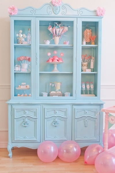 pink and blue china cabinet..