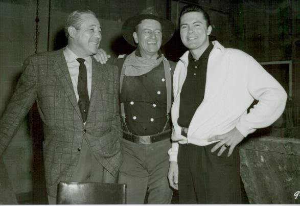 THE HORSE SOLDIERS (1958) - John Wayne on the movie set with boxer Max Baer & his actor son, Max Baer Jr. - United Artists - Publicity Still.
