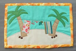 does it get any better ~ 3 of my favorite things ... quilt, clothesline and a tropical island!!