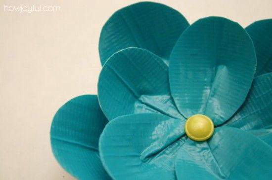 How to Make a Duct Tape Flower - {free pattern} ~ Download the free file pattern to make a pretty duct tape flower.  Attach a paper clip to the back of the flower to decorate a frame or you can turn it into a gorgeous hair accessory.