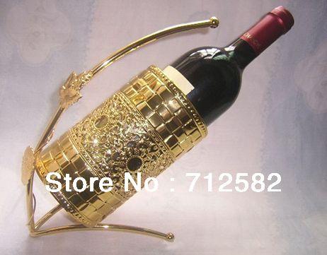 Cheap Whisky champán metálico sostenedor de botella de vino botella hallow estante de exhibición tallado plateado 1 unid envío gratis, Compro Calidad Estanerías de Vino directamente de los surtidores de China:        Nombre del producto:             Hierro champán whisky vino hallow estante de exhibición del sostenedor de botell