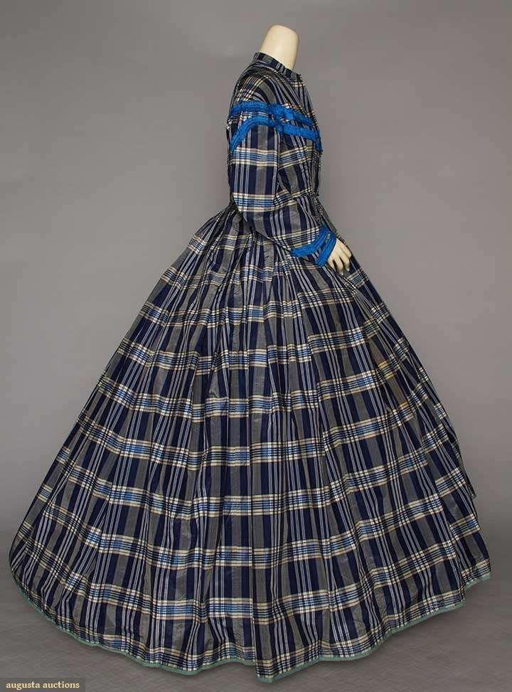 PLAID TAFFETA DAY DRESS, EARLY 1860s. Blue & white plaid silk, very full pleated skirt, blue silk w/ black & white striped ribbon trim.