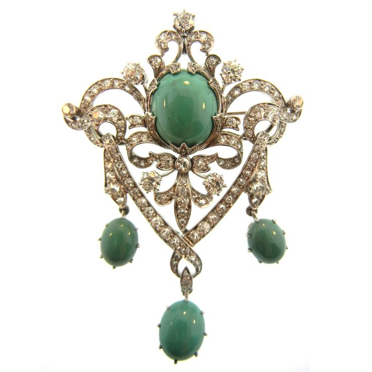 A Black, Starr and Frost lacework pendent/brooch with platinum, white gold, diamond, and Persian turquoise. Circa 1910