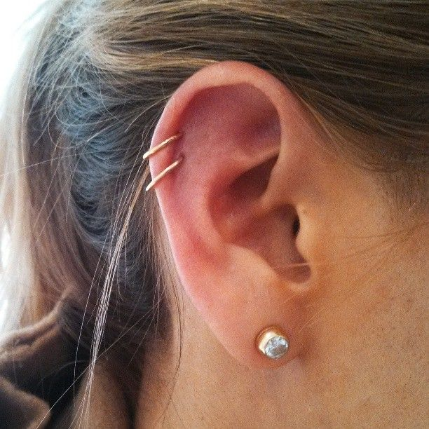 Double cartilage piercings with 14k yellow gold clickers from Maria Tash