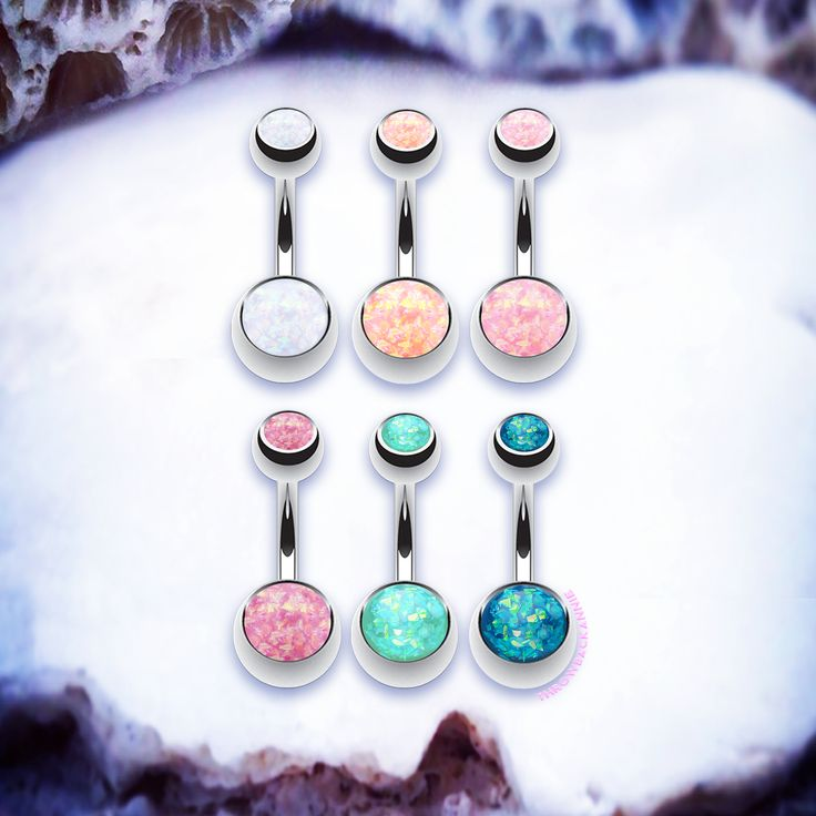 Our mermaid faux opal belly bars are the perfect festival touch for your belly button piercing! Rock the opal navel jewellery and take inspo from celebs with their belly buttons pierced like Vanessa Hudgens! For all your boho babes and beach lovers these iridescent belly button rings are ultra  stunning! Fierce and bright these simple navel rings can go from street to sleek!