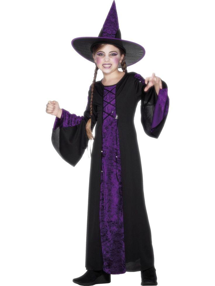 Neiti Noita. Naamiaisasu on laadukas ja tyylikäs tyttöjen naamiaisasu. Pitkähelmaista mekkoa somistaa violetti etumus ja hihansuut, myös päähineestä löytyy tuota noitamaisen tyylikästä väriä.