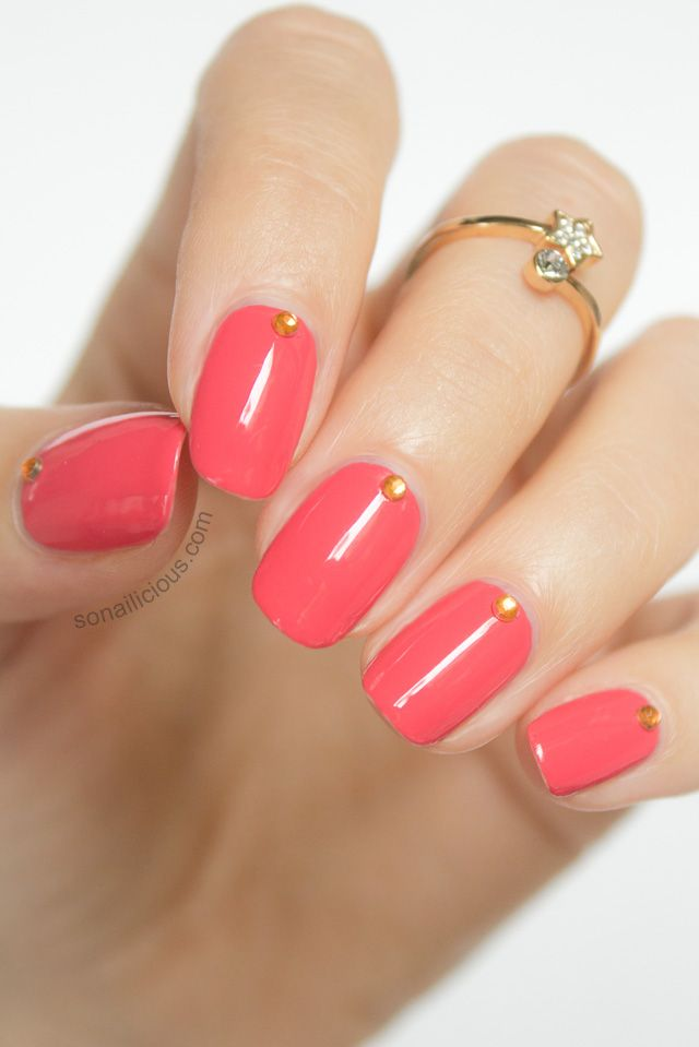 Beautiful Coral nails with studs. Click for manicure details. #nails #nailart #coral