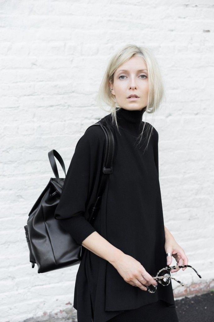 Chic Style - all black outfit with leather backpack & tucked hair