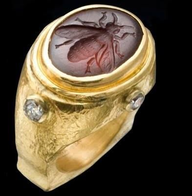 This ring is listed as a 22K Roman ring with Rhodolite Garnet Bee Intaglio with Diamond. But to me it looks as if the diamond is cut... The Garnet Bee is wonderful