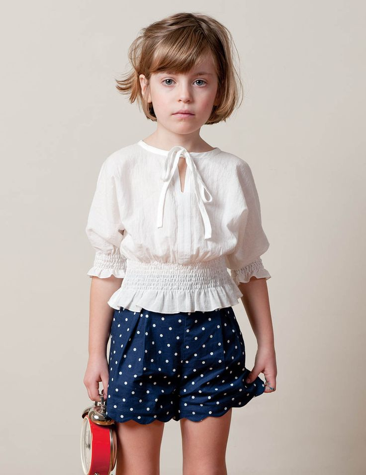 navy & white. This little girl reminds me of my sister when she was little.