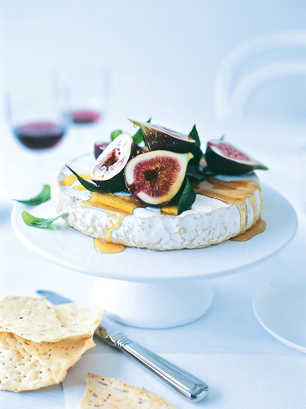 A beautiful appetizer idea......marinated figs with a wheel of brie on a cake stand