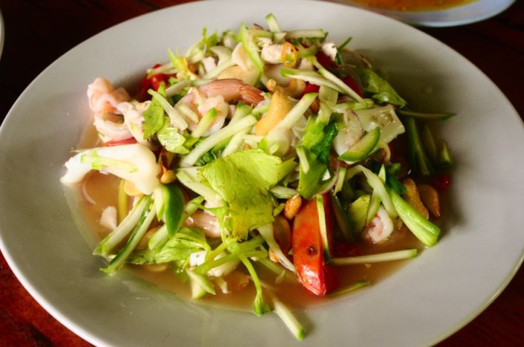 Thai salads are the best! A delicious and fiery green mango seafood salad